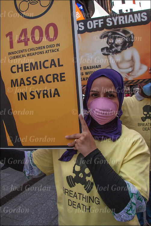 """Female Muslim protester holding signs 'Protest Syria chemical massacre"""" in Times Square"""