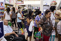 March 13, 2014 - Singapore. Anandha does the shopping for the family, after packing everything in the fridge she notes down her expenses her a note book. This is not at the request of her employer, but just because she likes to be organized. © Nicolas Axelrod / Ruom