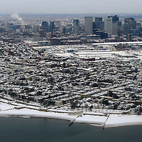 (Boston, MA - 2/10/15) A snow-covered Boston is seen from the air [South Boston beaches are in foreground], Monday, February 10, 2015. Staff photo by Angela Rowlings.