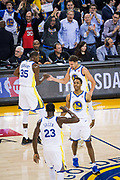 The Golden State Warriors celebrate a three pointer against the Houston Rockets at Oracle Arena in Oakland, Calif., on October 17, 2017. (Stan Olszewski/Special to S.F. Examiner)