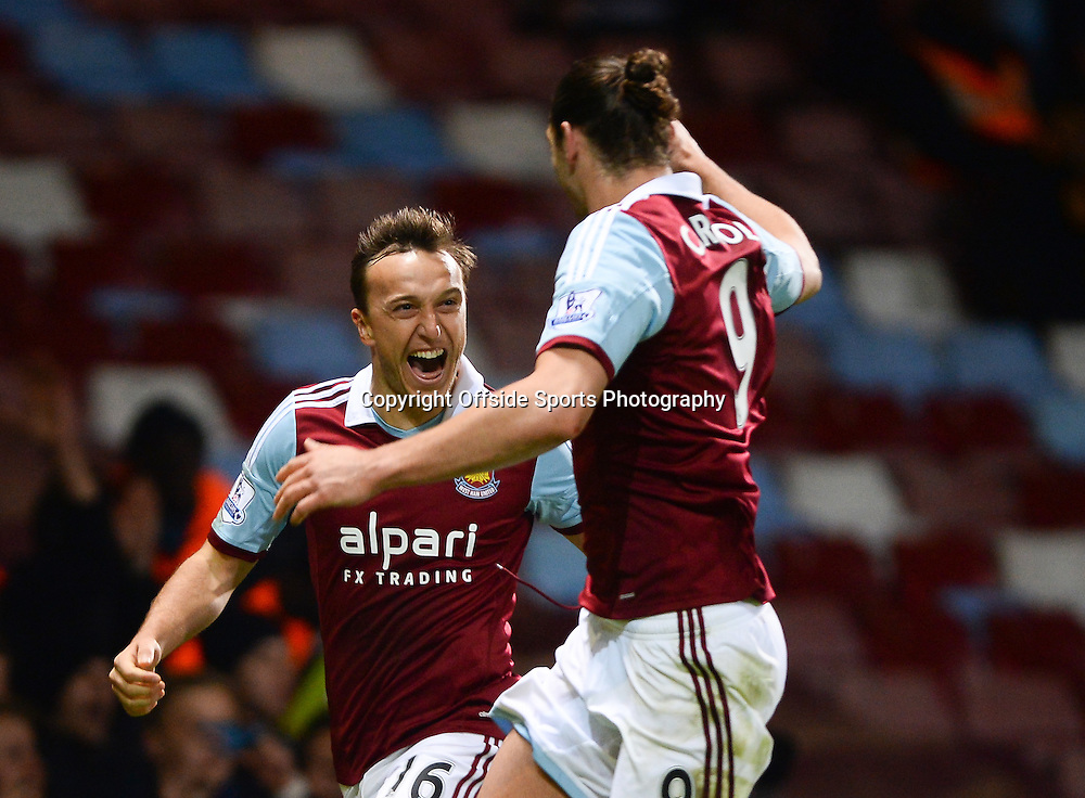 26 March 2014 - Barclays Premier League - West Ham United v Hull City - Mark Noble of West Ham United celebrates scoring the opening goal with Andy Carroll - Photo: Marc Atkins / Offside.