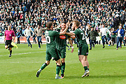 Graham Carey (10) of Plymouth Argyle, Gary Miller (2) of Plymouth Argyle and David Fox (24) of Plymouth Argyle celebrate as Argyle fans invade the pitch to celebrate promotion at full time during the EFL Sky Bet League 2 match between Plymouth Argyle and Newport County at Home Park, Plymouth, England on 17 April 2017. Photo by Graham Hunt.