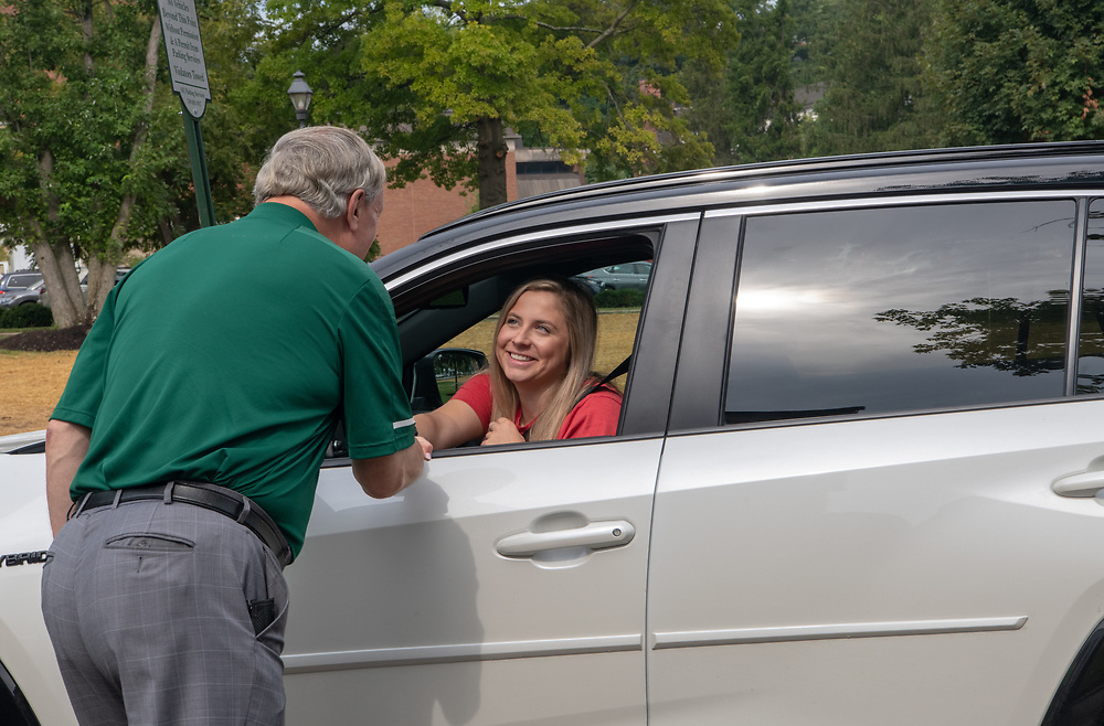 Ohio University President M. Duane Nellis greets a student on move- in day at a residence hall on South Green.