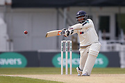Yorkshire All-rounder Adil Rashid plays and misses during the Specsavers County Champ Div 1 match between Yorkshire County Cricket Club and Surrey County Cricket Club at Headingley Stadium, Headingley, United Kingdom on 10 May 2016. Photo by Simon Davies.