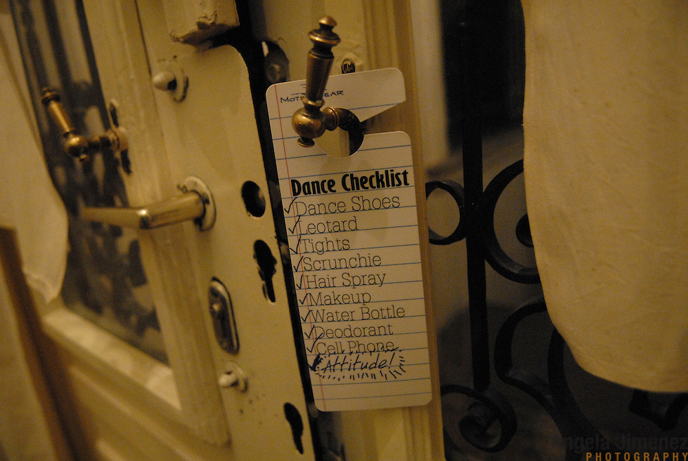"A sign hangs on the doorknob of World Champion same-sex ballroom dancer Gergely Darabos' apartment in Budapest, Hungary on October 19, 2006. Darabos and his dancing partner, Robert Tristan Szelei, are preparing for the 2nd annual World Championship Same-Sex Ballroom Dancing competition, held in their hometown on October 21, 2006. ..Szelei and Darabos, who are known as the ""Black Swans,"" are the reigning world champions in men?s Latin same-sex ballroom dancing. They have been training and preparing to host the 2nd annual World Championship and the Csardas Cup, the first-ever Eastern European same-sex ballroom competition, both held at the Korcsarnok arena.  This is the pinnacle event of the blossoming same-sex ballroom scene...Szelei and Darabos went on to win the men?s Standard division and finished fourth in the Latin division. ..The event was organized by the US-based World Federation of Same-Sex Dancing, which hosted the first World Championship Same-Sex championships in 2005 in Sacramento, California. The Black Swans did a large amount of the coordination and planning in Budapest, a city that had never seen an event of this kind. When government funding fell through, they secured funding from patron Desire (accent on the ?e?) Dubounet, owner of the local Club Bohemian Alibi drag club. ..The World Championship events are newly recognized, but same-sex dancers have been competing on a national and international circuit for a number of years, especially in Europe, including at the Eurogames, the Gay Games, the London Pink Jukebox Trophy and the Berlin Open, among others. Countries including the United States, the Netherlands, Germany and, now, Hungary, hold their own national same-sex championships. Hungary held its first national championships in April 2006...Szelei and Darabos spent three months at the Sacramento Dancesport same-sex dance school in California this summer, on the first scholarship offered by the World Federation. The men both got their early train"