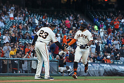 SAN FRANCISCO, CA - JUNE 12: Kevin Pillar #1 of the San Francisco Giants is congratulated by third base coach Ron Wotus #23 after hitting a home run against the San Diego Padres during the second inning at Oracle Park on June 12, 2019 in San Francisco, California. The San Francisco Giants defeated the San Diego Padres 4-2. (Photo by Jason O. Watson/Getty Images) *** Local Caption *** Kevin Pillar; Ron Wotus
