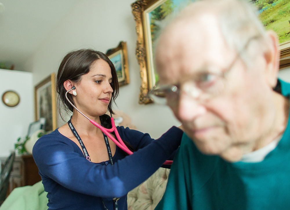 Strathroy, Ontario ---2015-05-13--- Becky Rutherford, a palliative care nurse with the VON Palliative Care Team checks Phillip McDonnell's vitals during a visit to his apartment in Strathroy, Ontario, May 13, 2015.<br /> GEOFF ROBINS The Globe and Mail