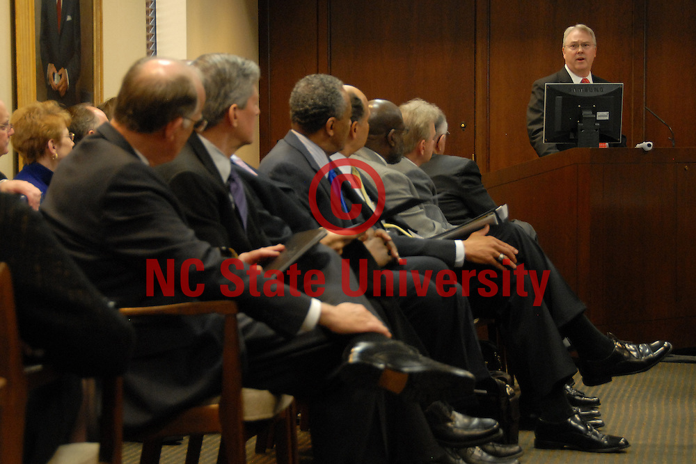Chancellor-elect Randy Woodson (right) addresses the UNC Board of Governors and as the chancellors of the other 15 UNC schols (left) look on. PHOTO BY RGER WINSTEAD