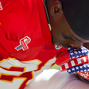Kansas City Chiefs running back Thomas Jones knelt in prayer prior to the game against the Buffalo Bills on Sunday, September 11, 2011, at Arrowhead Stadium in Kansas City, Mo. Jones wore patriotic gloves as a 10th anniversary tribute to those who died on 9/11.