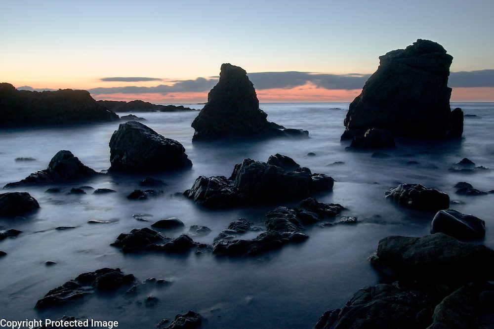 Rock formations and surf at twilight, Garapatta State Beach, Big Sur, California
