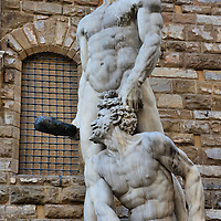 Hercules and Cacus Statue in Front of Palazzo Vecchio in Florence, Italy <br /> When the Medici family returned to power in 1512 and again in 1530, they commissioned Baccio Bandinelli to sculpt from Carrara marble this statue of Hercules after killing the giant Vulcan Cacus.  It clearly symbolized the House of Medici victory.  It still stands in the Piazza della Signoria in front of Palazzo Vecchio.  The Medicis were a royal family in the late 14th and 15th century that produced several dukes, two French queens and four Catholic popes.