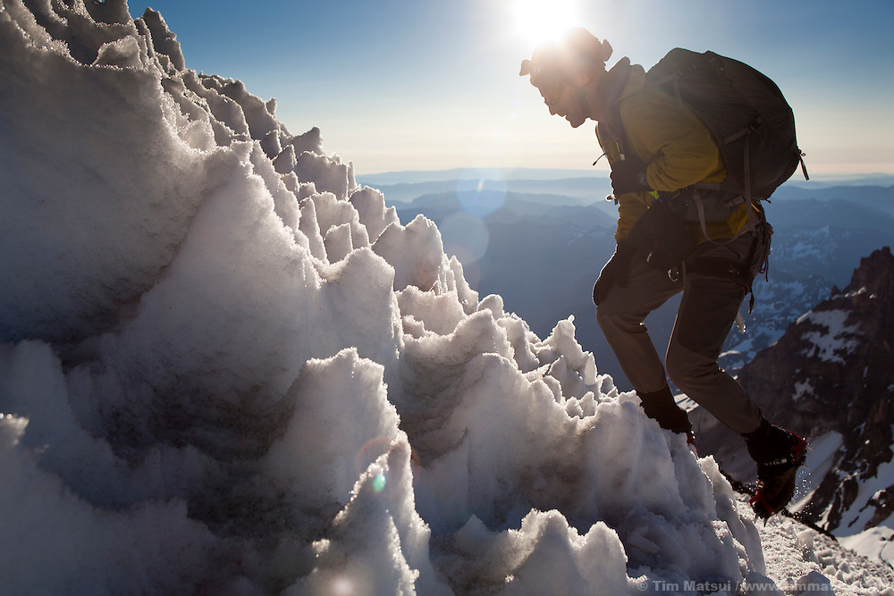 "Shortly after sunrise, Frank Huster, a Seattle photographer and software engineer, steps through ""nieves penitentes"" on the upper slopes of the Disappointment Cleaver during a 12-hour round trip climb of Mt. Rainier."
