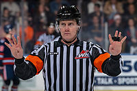 KELOWNA, BC - JANUARY 11: Referee Ward Pateman stands at centre ice signaling four on four to the benches of the Kelowna Rockets and Kamloops Blazers at Prospera Place on January 11, 2020 in Kelowna, Canada. (Photo by Marissa Baecker/Shoot the Breeze)