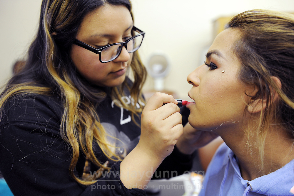 Jessica Ruiz, 18, practices her cosmetology skills on transgender prom queen Angie Esteban in their Regional Occupational Program (ROP) class in Salinas.