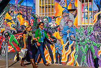 Women shopping along Central Avenue (historic Route 66) in Nob Hill, a mural of comic book super heroes in background, Albuquerque, New Mexico USA