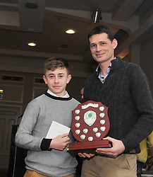 Cian McAllister was presented Team member of the Year Award from Paul McNamara Regional Athletics Officer Athletics Ireland at the Westport AC awards. Pic Conor McKeown