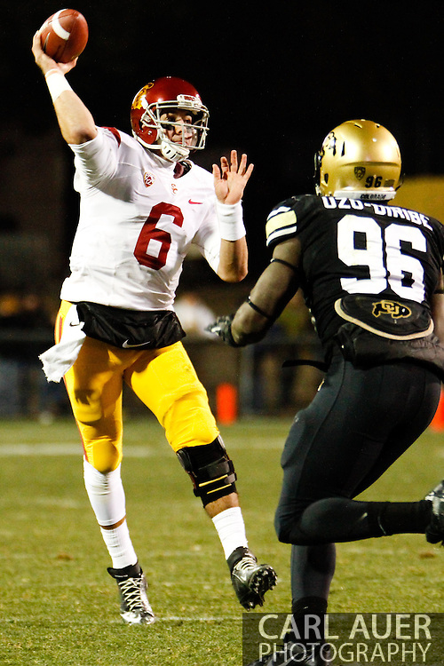 November 23rd, 2013:  USC Trojans sophomore quarterback Cody Kessler (6) throws the ball in the third quarter of the NCAA Football game between the University of Southern California Trojans and the University of Colorado Buffaloes at Folsom Field in Boulder, Colorado