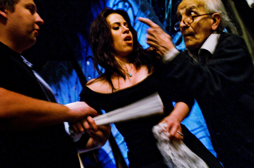 Amato Opera <br /> <br /> Tony Amato directing a couple of young singers during a rehersal.<br /> <br /> The Amato Opera company was founded by husband and wife Tony and Sally Amato in 1948. <br /> <br /> The opera house is located on The Bowery, in New York's East Village,  next door to where the legendary punk rock club CBGB used to be.<br /> <br /> While Tony acted as artistic director, selecting the productions, auditioning and casting, rehearsing and training the cast and conducting most of the performances, his wife Sally functioned as seamstress, light board operator, cook, box office manager, publicist, business manager, and, as Serafina Bellantoni, singer for the company until her death in 2000.<br /> <br /> Today Tony at the age of 88 is still running the company like he promised his wife he would, and the Amato Opera maintains its goals of providing opera at a reasonable price and giving promising singers stage experience in full-lenght productions.<br /> <br /> Photographer: Chris Maluszynski /MOMENT