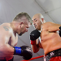 080115       Cable Hoover<br /> <br /> Gallup boxer Ron Baca swings a hard left at Manuel Otero in the first match of Fire and Ice Fury boxing in Grants Saturday.