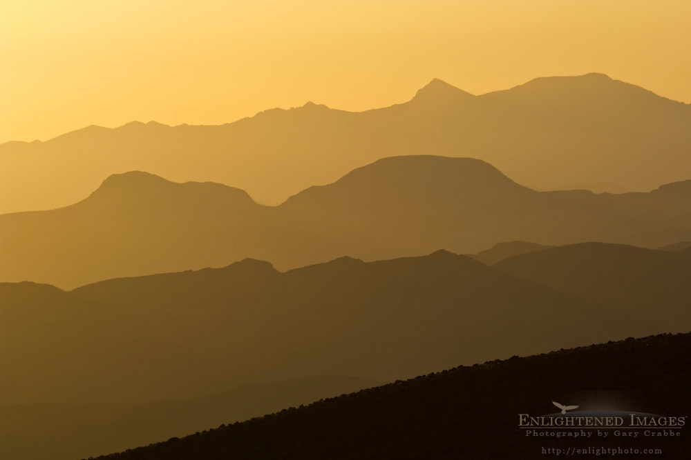 Sunrise light behind mountain ridges, from Dantes View, Death Valley National Park, California