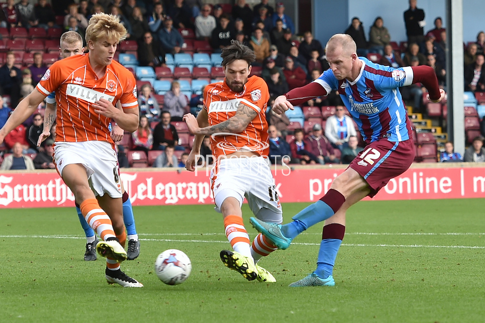 Neil Bishop  blocked by Brad Potts  during the Sky Bet League 1 match between Scunthorpe United and Blackpool at Glanford Park, Scunthorpe, England on 5 September 2015. Photo by Ian Lyall.