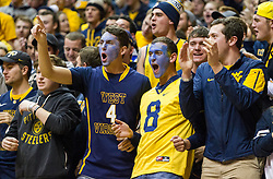 Jan 12, 2016; Morgantown, WV, USA; West Virginia Mountaineers students react during the first half against the Kansas Jayhawks at the WVU Coliseum. Mandatory Credit: Ben Queen-USA TODAY Sports