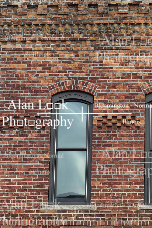 Brick building facade with detail work and arch topped windows