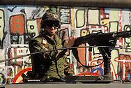 DEU, Germany, Berlin, at the wall in the district Kreuzberg, American soldier, patrol car with machine gun.....DEU, Deutschland, Berlin, Amerikanischer Soldat an der Mauer in Kreuzberg, Patrouillenfahrzeug mit Maschinengewehr...1988