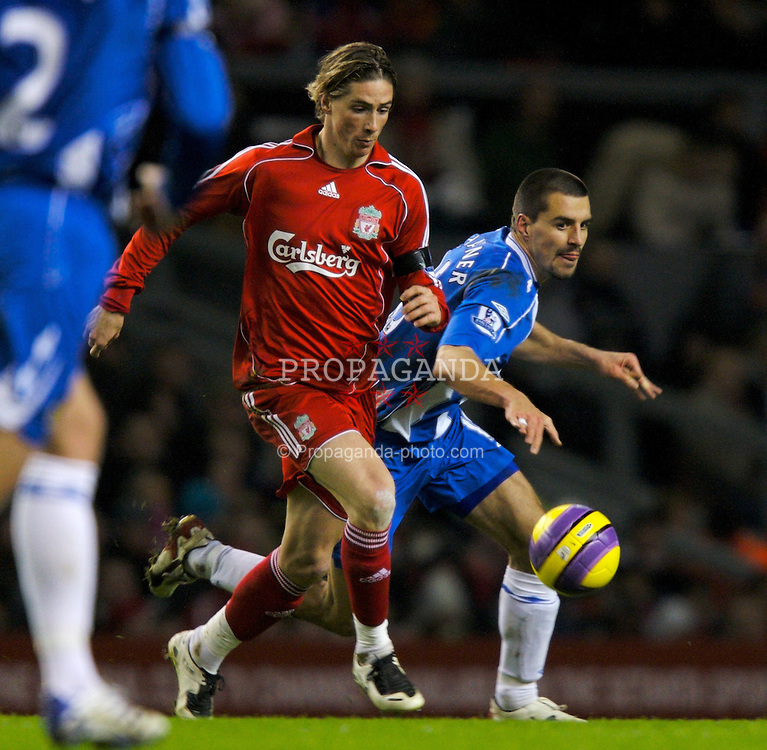 LIVERPOOL, ENGLAND - Wednesday, January 2, 2008: Liverpool's Fernando Torres and Wigan Athletic's Paul Scharner during the Premiership match at Anfield. (Photo by David Rawcliffe/Propaganda)