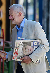 © Licensed to London News Pictures. 10/06/2017. London, UK. Leader of the Labour Party JEREMY CORBYN carrying a copy of the Daily Mirror newspaper near his London home. The Labour party made significant gains earlier this week in a general election The Conservative Party were expected to win comfortably. Photo credit: Ben Cawthra/LNP