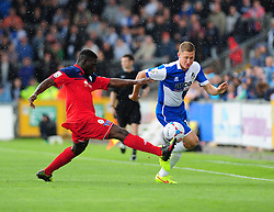 AFC Telford's Godfrey Poku challenges Bristol Rovers' Dave Martin - Photo mandatory by-line: Neil Brookman - Mobile: 07966 386802 23/08/2014 - SPORT - FOOTBALL - Bristol - Memorial Stadium - Bristol Rovers v AFC Telford - Vanarama Football Conference