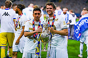 Leeds United midfielder Pablo Hernandez (19) and Leeds United forward Patrick Bamford (9) pose with the trophy during the EFL Sky Bet Championship match between Leeds United and Charlton Athletic at Elland Road, Leeds, England on 22 July 2020.