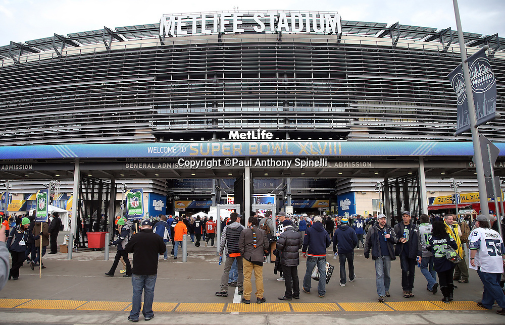 Fans walk around MetLife Stadium in this exterior general view of the stadium before the NFL Super Bowl XLVIII football game between the Seattle Seahawks and the Denver Broncos on Sunday, Feb. 2, 2014 in East Rutherford, N.J. The Seahawks won the game 43-8. ©Paul Anthony Spinelli