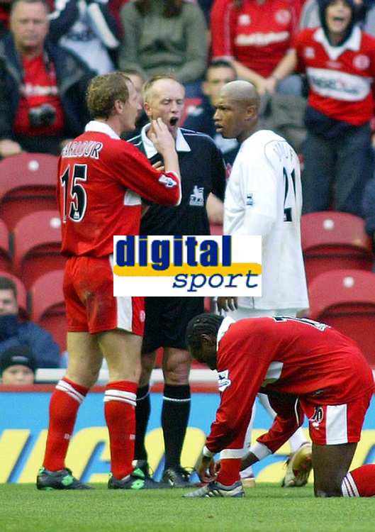 7/11/2004 - FA Barclayship Premiership - Middlesbrough v Bolton Wanderers - The Riverside Stadium<br />Referee Peter Walton parts an arguing Middlesbrough's Ray Parlour and Bolton Wanderers' El Hadj Diouf, as Parlour suggested that the Bolton player smells<br />Photo:Jed Leicester/Back Page Images
