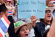 "Apr. 18, 2010 - Bangkok, Thailand: A Pink Shirt peace protestor shows support for the King of Thailand during a peace rally Sunday. Thousands of so called ""Pink Shirts"" jammed the area around Victory Monument in Bangkok to show support the Thai Monarch, King Bhumibol Adulyadej, and against the Red Shirts, who are demonstrating just a few kilometres away in the Ratchaprasong area. The Pink Shirts claim to not support either of the other political factions who wear colors - the Red Shirts, who support deposed Prime Minister Thaksin Shinawatra and their opponents the Yellow Shirts, who are against Thaksin.   Photo By Jack Kurtz"