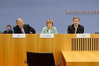 """24 JAN 2003, BERLIN/GERMANY:<br /> Roland Koch, CDU, Ministerpraesident Hessen, Angela Merkel, CDU Bundesvorsitzende, Christian Wulff, CDU Landesvorsitzender Niedersachsen, (v.L.n.R.), waehrend einer Pressekonferenz zu dem Thema """"100 Tage Rot-Gruen"""", Bundespressekonferenz<br /> IMAGE: 20030124-01-008<br /> KEYWORDS: Spitzenkandidat"""