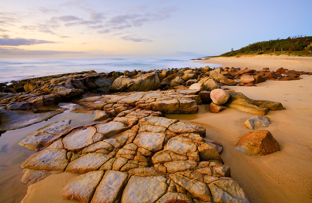 The captivating patterns of these rocks make an excellent subject for this pre dawn shot on Yaroomba beach.