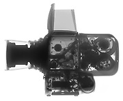 A Hasselblad 500EL medium format camera is shown in X-ray. This is the model of camera used by the Apollo Astronauts on the surface of the moon. To save weight, only the film pack containing the exposed film was returned to earth. The camera body and lens were left on the surface of the moon.
