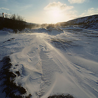 Europe, Norway, Snow-covered, empty hills along Russian border outside arctic coast town of Kirkennes in winter