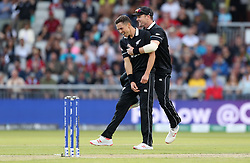 New Zealand's Trent Boult celebrates taking the wicket of West Indies Nicholas Pooran with Colin Munro during the ICC Cricket World Cup group stage match at Old Trafford, Manchester.