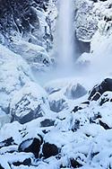 Bridalveil Falls forms an icy sheen on the rocks below, Yosemite National Park, CA.