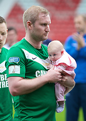 WREXHAM, WALES - Saturday, May 3, 2014: Aberystwyth Town's Peter Hoy with his baby after the Welsh Cup Final against The New Saints at the Racecourse Ground. (Pic by David Rawcliffe/Propaganda)