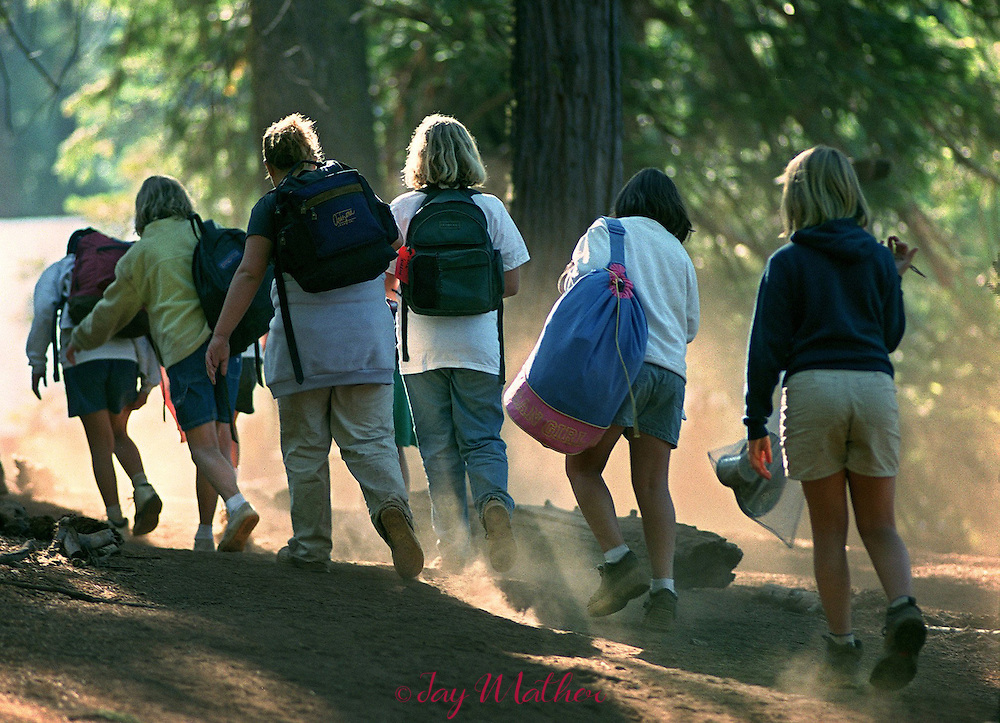 It's the end of an eight-day stay at Camp Menzies near Arnold, CA for Girl Scouts from the Sacramento and Central valley regions as they trudge toward the chartered buses to take them home.  July 3, 2000.