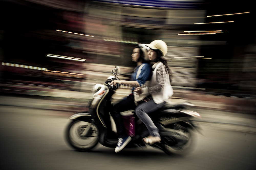 Driving scooter at night, French Quarter, Hanoi, Vietnam