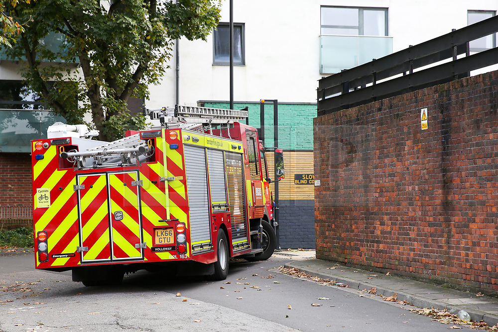 © Licensed to London News Pictures. 28/10/2019. London, UK. A fire engine is seen on Mingard Walk in Islington, north London. <br /> Detectives have launched a murder investigation after a woman died in a fire at a residential address in Islington.<br /> Police were called at 12:41hrs on Saturday, 26 October following reports of a fire in a flat on Mingard Walk, N7.<br /> Officers attended along with the London Ambulance Service and the London Fire Brigade. A woman [no further details at this time] was pronounced dead at the scene. A man, believed to be aged in his 30s, was found suffering serious injuries. He was taken to hospital where he remains in a critical condition. <br /> The fire is being treated as suspicious. Photo credit: Dinendra Haria/LNP