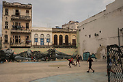 A group of children plays ball in  Havana, Cuba.