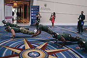 "A group from Gen Opp drop and do push ups as they roam the halls during day two of the Conservative Political Action Conference (CPAC) at the Gaylord National Resort & Convention Center in National Harbor, Md.Gen Opp and Young Americans for Liberty have partnered for CPAC to ""enlist young people to fight back against the<br /> War on Youth that the govt has waged,"" according to Gen Opp communications and writing associate, Daisy Letendre."