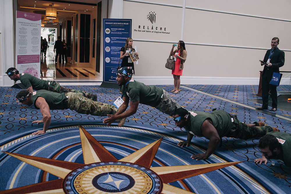 A group from Gen Opp drop and do push ups as they roam the halls during day two of the Conservative Political Action Conference (CPAC) at the Gaylord National Resort &amp; Convention Center in National Harbor, Md.Gen Opp and Young Americans for Liberty have partnered for CPAC to &quot;enlist young people to fight back against the<br /> War on Youth that the govt has waged,&quot; according to Gen Opp communications and writing associate, Daisy Letendre.