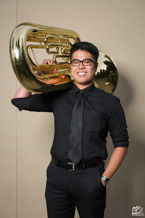 Johnathan Yenng, MHS senior, poses for a portrait with his tuba before performing in the Milpitas Unified School District's 11th Annual Music Festival at Milpitas High School in Milpitas, California, on April 10, 2014. (Stan Olszewski/SOSKIphoto)