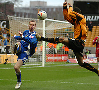 Photo: Ed Godden.<br />Wolverhampton Wanderers v Cardiff City. Coca Cola Championship. 11/03/2006. Rhys Weston (L) is tackled by Wolves player Jeremie Aliadiere.